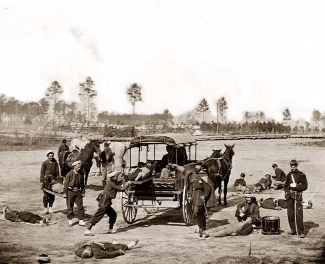 This is a stunning photograph from 1862. The image shows a Civil War Ambulance crew removing the wounded from a battlefield. It shows a horse-drawn ambulance, and the Zouave uniforms of this unit.